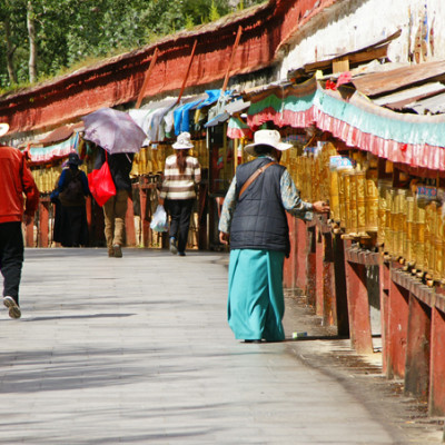 Turning the prayer wheels around the Potala Palace